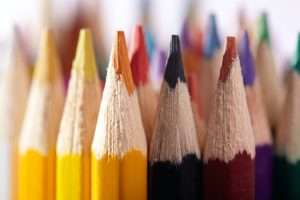 The sharp tips of an array of colored pencils.